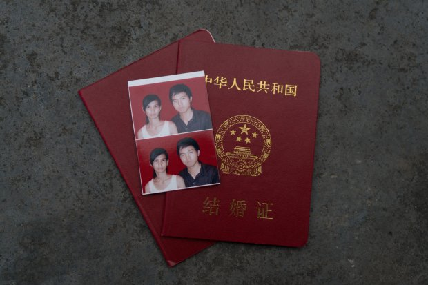 Liu Hua and Sreynich Yorn and their marriage certificate from 2013. MUSTCREDIT: Photo for The Washington Post by Yan Cong