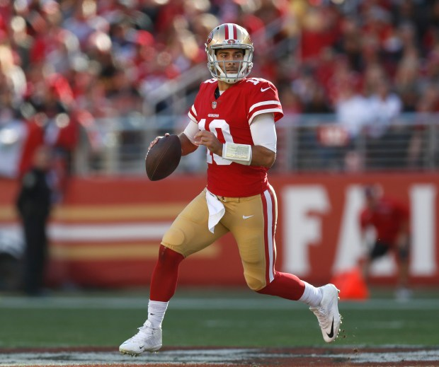 San Francisco 49ers starting quarterback Jimmy Garoppolo (10) looks to pass against the Tennessee Titans in the first quarter of their NFL game at Levi's Stadium in Santa Clara, Calif., on Sunday, Dec. 17, 2017. (Nhat V. Meyer/Bay Area News Group)