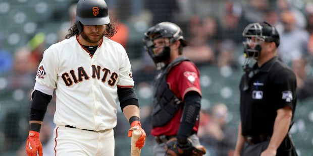 San Francisco Giants shortstop Brandon Crawford (35) walks off the field after striking out swinging against Arizona Diamondbacks relief pitcher Brad Boxberger (31) in the ninth inning of their MLB game at AT&T Park in San Francisco, Calif., on Wednesday, April 11, 2018. (Jane Tyska/Bay Area News Group)