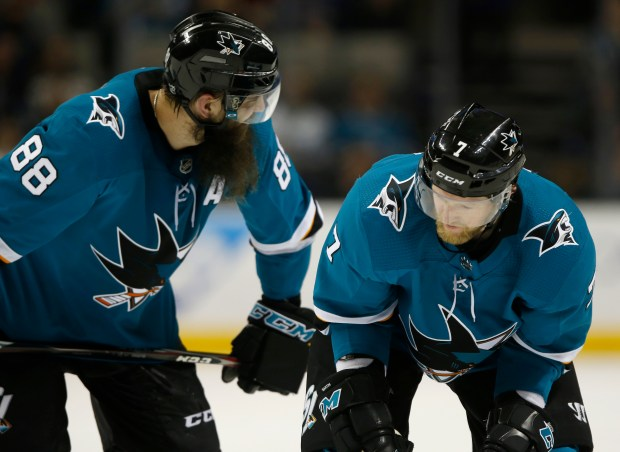 San Jose Sharks' Brent Burns (88) talks to San Jose Sharks' Paul Martin (7) before a face-off against the Colorado Avalanche in the third period at the SAP Center in San Jose, Calif., on Thursday, April 5, 2018. (Nhat V. Meyer/Bay Area News Group)