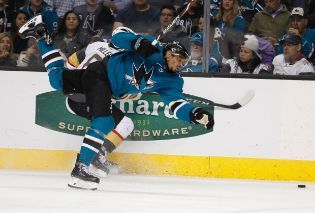 San Jose Sharks' Evander Kane (9) fights for the puck against Las Vegas Knights' Colin Miller (6) in the second period of Game 3 in the second-round of the NHL Stanley Cup Playoffs in San Jose, Calif., on Monday, April 30, 2018. (Nhat V. Meyer/Bay Area News Group)
