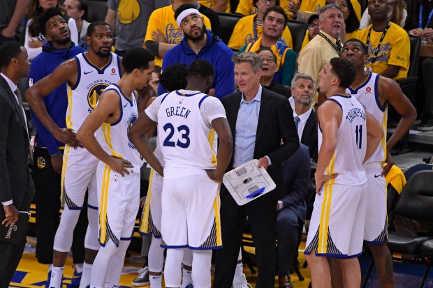 Golden State Warriors head coach Steve Kerr speaks to his players during a timeout against the San Antonio Spurs in the second quarter of Game 1 of their NBA first-round playoff series at the Oracle Arena in Oakland, Calif., on Saturday, April 14, 2018. (Jose Carlos Fajardo/Bay Area News Group)