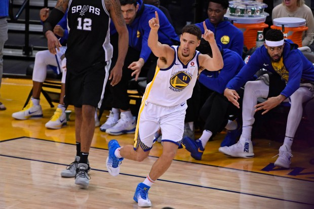 Golden State Warriors' Klay Thompson (11) reacts after scoring a three-point basket over San Antonio Spurs' LaMarcus Aldridge (12) during the third quarter of Game 1 of their NBA first-round playoff series at the Oracle Arena in Oakland, Calif., on Saturday, April 14, 2018. (Jose Carlos Fajardo/Bay Area News Group)