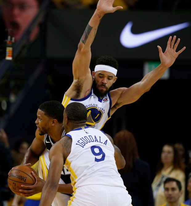 Golden State Warriors' Javale McGee (1) guards against San Antonio Spurs' LaMarcus Aldridge (12) in the third quarter of Game 1 of their NBA first-round playoff series at the Oracle Arena in Oakland, Calif., on Saturday, April 14, 2018. (Nhat V. Meyer/Bay Area News Group)