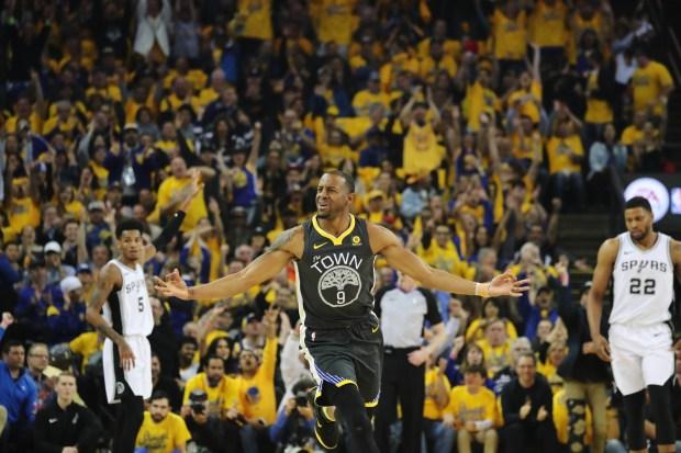 Golden State Warriors' Andre Iguodala (9) celebrates after scoring a bucket during the first quarter of Game 2 of their NBA first-round playoff series at Oracle Arena in Oakland, Calif., on Monday, April 16, 2018. (Ray Chavez/ Bay Area News Group)