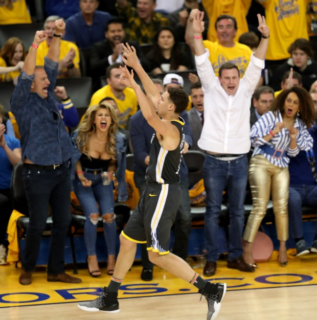 Golden State Warriors' Klay Thompson (11) celebrates a 3-point basket against the San Antonio Spurs during the fourth quarter of Game 2 of their NBA first-round playoff series at Oracle Arena in Oakland, Calif., on Monday, April 16, 2018.(Ray Chavez/Bay Area News Group)