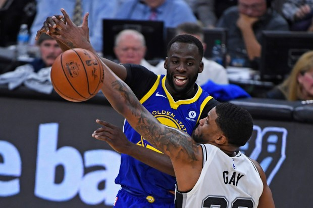 Golden State Warriors' Draymond Green (23) passes the ball while being guarded by San Antonio Spurs' Rudy Gay (22) during the second quarter of Game 3 of their NBA first-round playoff series at AT&T Center in San Antonio, Texas, on Thursday, April 19, 2018. (Jose Carlos Fajardo/Bay Area News Group)