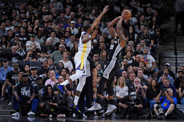 San Antonio Spurs' Rudy Gay (22) shoots over Golden State Warriors' Kevin Durant (35) during the first quarter of Game 4 of their NBA first-round playoff series at AT&T Center in San Antonio, Texas, on Sunday, April 22, 2018. (Jose Carlos Fajardo/Bay Area News Group)