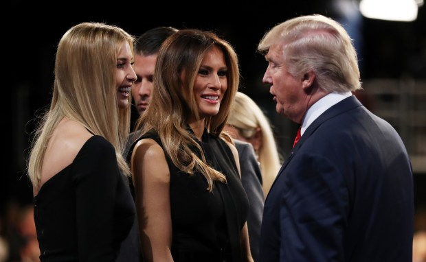 Republican presidential nominee Donald Trump speaks with his wife Melania Trump and his daughter Ivanka Trump after the third U.S. presidential debate at the Thomas & Mack Center on October 19, 2016 in Las Vegas, Nevada. Tonight is the final debate ahead of Election Day on November 8. (Photo by Joe Raedle/Getty Images)