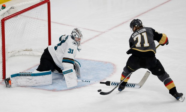 Vegas Golden Knights center William Karlsson (71) scores on San Jose Sharks goaltender Martin Jones (31) during the third period of an NHL hockey game, Saturday, March 31, 2018, in Las Vegas. Vegas defeated San Jose 3-2. (AP Photo/John Locher)