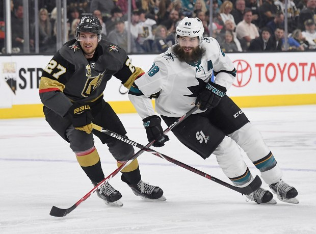 Shea Theodore #27 of the Vegas Golden Knights and Brent Burns #88 of the San Jose Sharks skate in the first period of their game at T-Mobile Arena on March 31, 2018 in Las Vegas, Nevada. The Golden Knights won 3-2 and clinched the Pacific Division title. (Photo by Ethan Miller/Getty Images)
