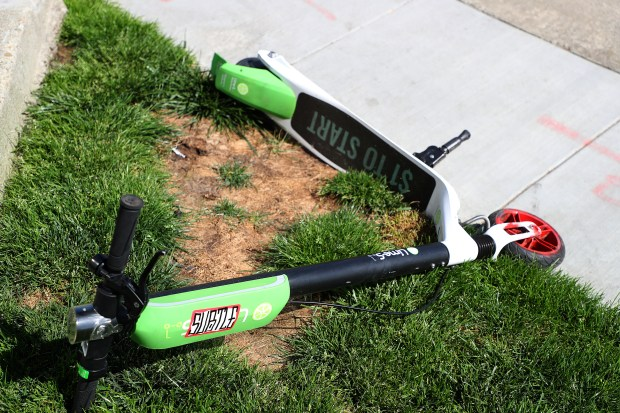 A Lime-S electric scooter is photographed along Lakeside Drive on Sunday, April 8, 2018, in Oakland, Calif. (Aric Crabb/Bay Area News Group)