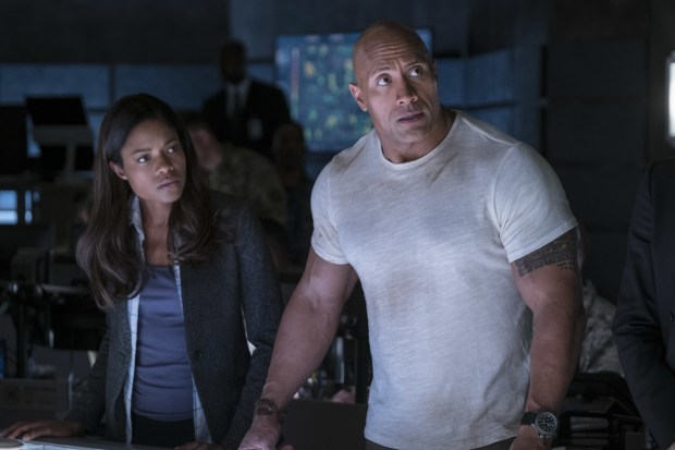 "This image released by Warner Bros. shows Naomi Harris, left, and Dwayne Johnson in a scene from ""Rampage."" (Frank Masi/Warner Bros. via AP)"