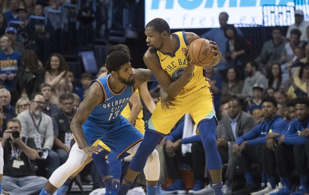 Paul George #13 of the Oklahoma City Thunder applies pressure as Kevin Durant #35 of the Golden State Warriors looks for a shot during the first half of a NBA game at the Chesapeake Energy Arena on April 3, 2018 in Oklahoma City, Oklahoma. (Photo by J Pat Carter/Getty Images)