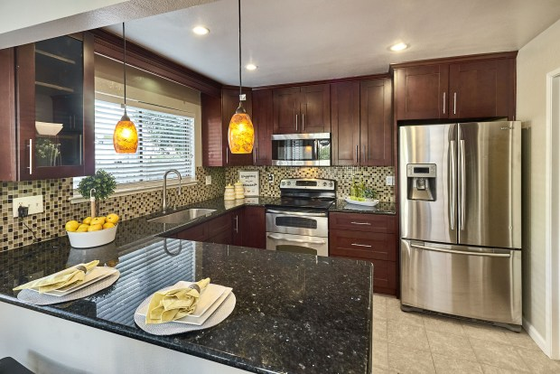 The updated kitchen includes many amenities.