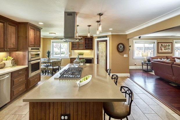 The spacious, open kitchen flows into the casual corner dining nook and expansive great room.