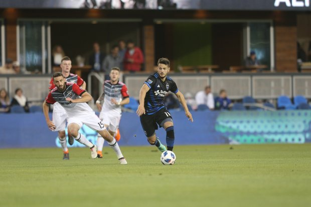 Valeri Qazaishvili (11) tries to move upfield Saturday night May 19, 2018against D.C. United's defense in a 3-1 home defeat for the San Jose Earthquakes. (ISI Photos) Can use online Can use in other DFM pubs