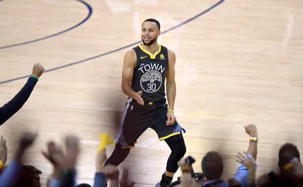 Golden State Warriors' Stephen Curry (30) gestures after making a basket in the first period of their NBA Western Conference semifinals game against the New Orleans Pelicans at Oracle Arena in Oakland, Calif., on Tuesday, May 1, 2018. (Doug Duran/Bay Area News Group)