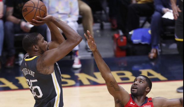 Golden State Warriors' Kevin Durant (35) takes a shot against New Orleans Pelicans' E'Twaun Moore (55) in the first quarter of Game 4 of the NBA Western Conference semifinals at the Smoothie King Center in New Orleans, LA, on Sunday, May 6, 2018. (Nhat V. Meyer/Bay Area News Group)