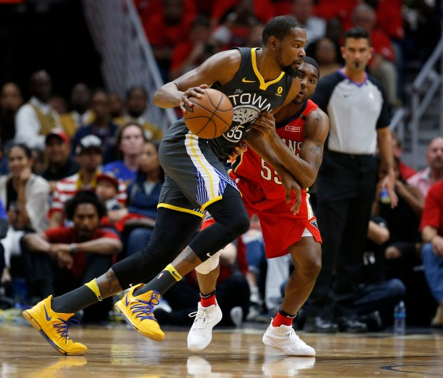 Golden State Warriors' Kevin Durant (35) dribbles against New Orleans Pelicans' E'Twaun Moore (55) in the second quarter of Game 4 of the NBA Western Conference semifinals at the Smoothie King Center in New Orleans, LA, on Sunday, May 6, 2018. (Nhat V. Meyer/Bay Area News Group)