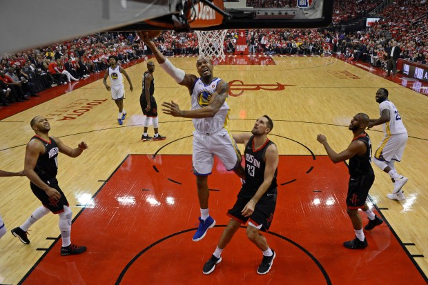 Golden State Warriors' David West (3) shoots over Houston Rockets' Ryan Anderson (33) during the first half of Game 1 of the NBA Western Conference finals at Toyota Center in Houston, Texas, on Monday, May 14, 2018. The Golden State Warriors defeated the Houston Rockets 119-106. (Jose Carlos Fajardo/Bay Area News Group)
