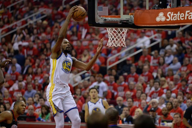 Golden State Warriors' Kevin Durant (35) goes up for a layup against the Houston Rockets during the first quarter of Game 1 of the NBA Western Conference finals at Toyota Center in Houston, Texas, on Monday, May 14, 2018. The Golden State Warriors defeated the Houston Rockets 119-106. (Jose Carlos Fajardo/Bay Area News Group)
