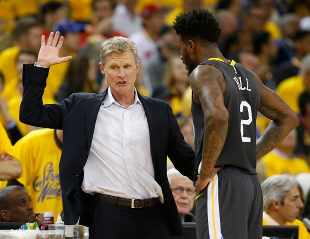 Golden State Warriors head coach Steve Kerr talks to Golden State Warriors' Jordan Bell (2) during their game against the Houston Rockets in the second quarter of Game 4 of the NBA Western Conference finals at Oracle Arena in Oakland, Calif., on Tuesday, May 22, 2018. (Nhat V. Meyer/Bay Area News Group)