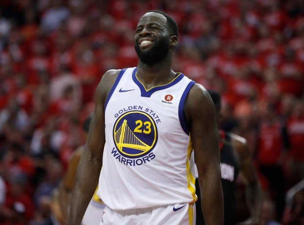 Golden State Warriors' Draymond Green (23) grimaces during their game against the Houston Rockets in the fourth quarter of Game 5 of the NBA Western Conference finals at the Toyota Center in Houston, Texas., on Thursday, May 24, 2018. (Nhat V. Meyer/Bay Area News Group)