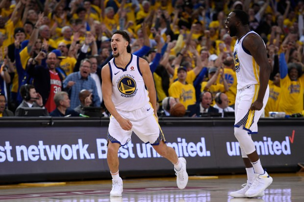Golden State Warriors' Klay Thompson (11) reacts after making a 3-point basket against the Houston Rockets during the fourth quarter of Game 6 of the NBA Western Conference finals at Oracle Arena in Oakland, Calif., on Saturday, May 26, 2018. The Golden State Warriors defeated the Houston Rockets 115-86. (Jose Carlos Fajardo/Bay Area News Group)