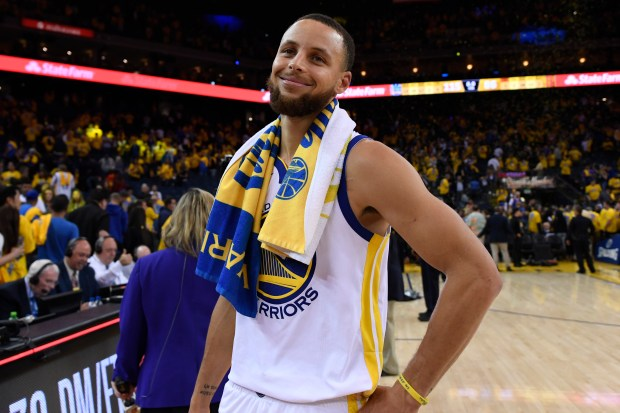Golden State Warriors' Stephen Curry (30) smiles as he walks off the court after defeating the Houston Rockets during Game 6 of the NBA Western Conference finals at Oracle Arena in Oakland, Calif., on Saturday, May 26, 2018. The Golden State Warriors defeated the Houston Rockets 115-86. (Jose Carlos Fajardo/Bay Area News Group)