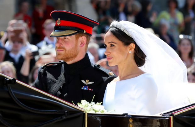 Britain's Prince Harry and his wife ...
