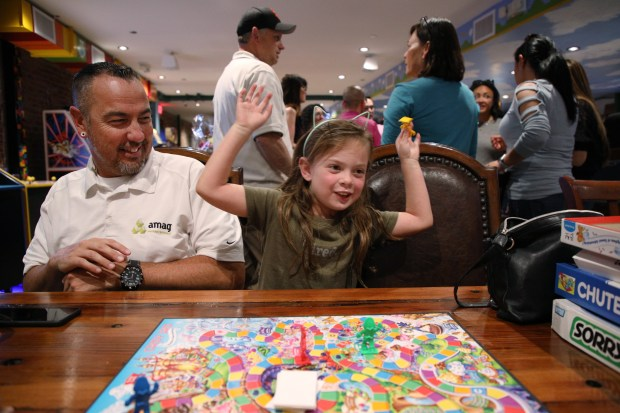 Taylynn Hattan, 6, of Campbell, celebrates winning Candyland as she plays with her parents, Jeff Hattan, at left, and Kristine Hattan, not in the picture, at Lvl Up, an arcade and gastropub, on Thursday, May 3, 2018, in Campbell, Calif. (Jim Gensheimer/Special to Bay Area News Group)