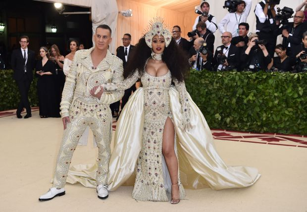 Cardi B and Jeremy Scott arrive for the 2018 Met Gala on May 7, 2018, at the Metropolitan Museum of Art in New York. - The Gala raises money for the Metropolitan Museum of Arts Costume Institute. The Gala's 2018 theme is Heavenly Bodies: Fashion and the Catholic Imagination. (Photo by Hector RETAMAL / AFP) (Photo credit should read HECTOR RETAMAL/AFP/Getty Images)