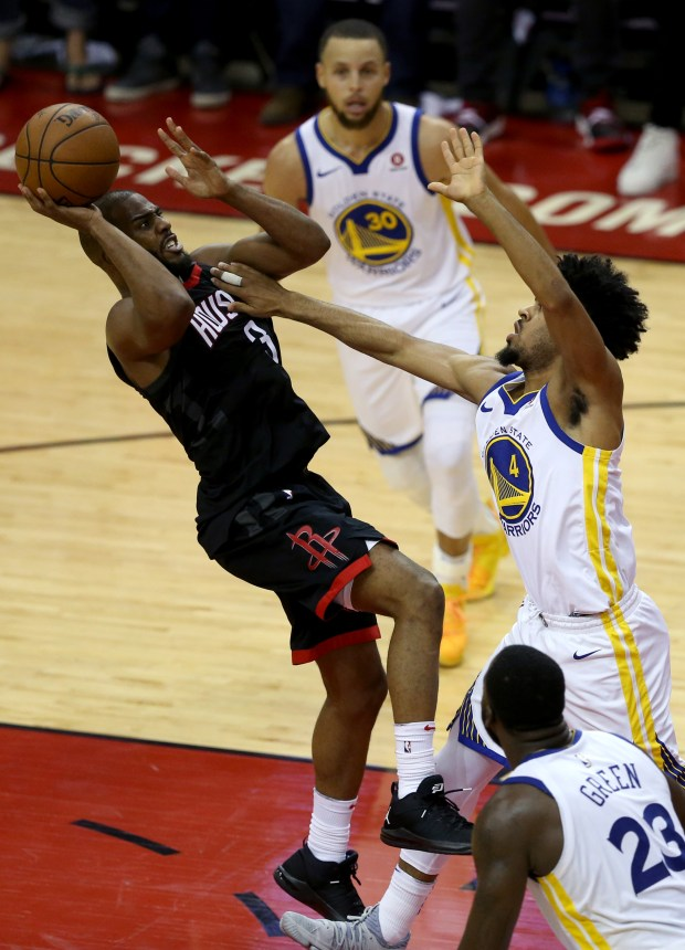 Houston Rockets' Chris Paul (3) shoots the ball against Golden State Warriors' Quinn Cook (4) in the fourth quarter of Game 5 of the NBA Western Conference finals at Toyota Center in Houston, Texas, on Thursday, May 24, 2018. (Anda Chu/Bay Area News Group)