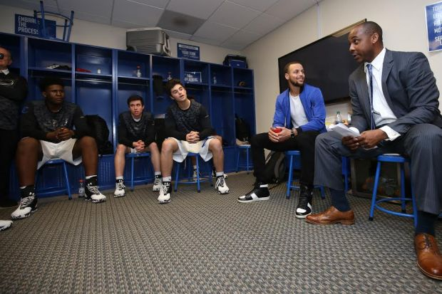 Stephen Curry meets with the Charlotte Christian basketball team and coach Shonn Brown during a visit in January to have his jersey retired by the school. (Courtesy Charlotte Christian School)