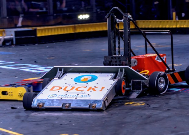 "DUCK!, Hal and Hannah Rucker's robot, is shown mid-battle with Mecha Rampage and Free Shipping, at right, during the premiere episode of ""BattleBots"" on May 11. (Jon C.R. Bennett / BattleBots)"
