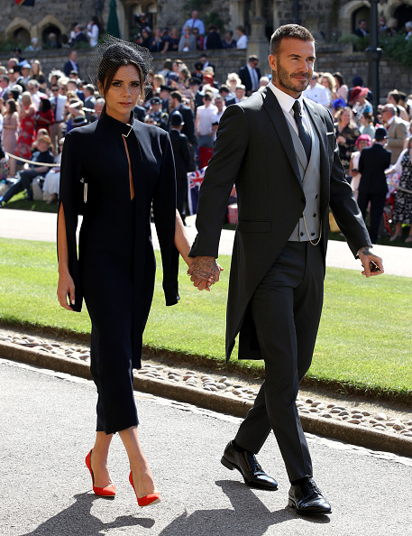 Victoria Beckham and David Beckham arrives for the wedding ceremony of Britain's Prince Harry and US actress Meghan Markle at St George's Chapel, Windsor Castle on May 19, 2018 in Windsor, England. (Photo by Chris Radburn - WPA Pool/Getty Images)