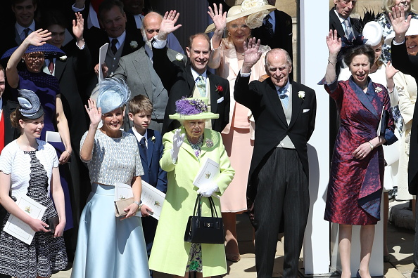 Queen Elizabeth II and Prince Philip, Duke of Edinburgh and other members of the royal family wave after the wedding of Prince Harry and Meghan Markle at St George's Chapel in Windsor Castle on May 19, 2018 in Windsor, England. (Photo by Andrew Milligan - WPA/Getty Images)