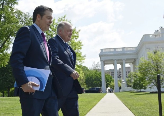 Association of Global Automakers President and CEO John Bozzella, left, and Ford Motor Company CEO Jim Hackett, right, arrive for a meeting with President Trump at the White House. (Susan Walsh/AP)
