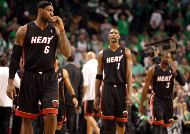 The Miami Heat's LeBron James (6), Chris Bosh (1) and Dwyane Wade (3) take the court in the final seconds of an 88-80 loss to the Boston Celtics in NBA action at the TD Center Arena in Boston, Massachusetts, on Tuesday, October 26, 2010. (Charles Trainor Jr./Miami Herald/MCT)