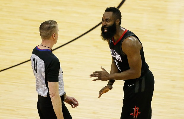James Harden #13 of the Houston Rockets argues a call with referee Ed Malloy #14 in the second half against the Golden State Warriors in Game Two of the Western Conference Finals of the 2018 NBA Playoffs at Toyota Center on May 16, 2018 in Houston, Texas. (Photo by Tim Warner/Getty Images)