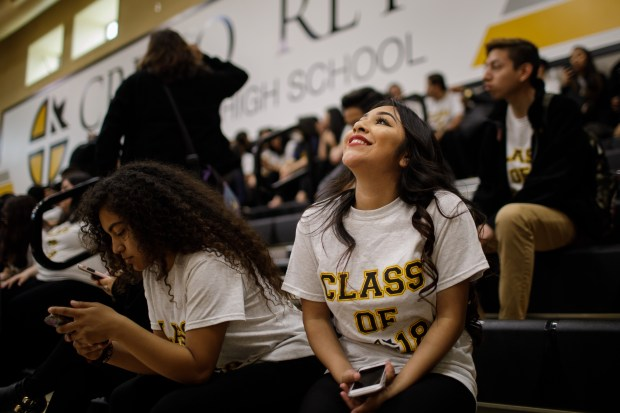 Graduating senior Coraima Bolanos Alejo, 17, of San Jose listens to a fellow student during a school event, where college-bound seniors announced their university or college choice in front of their family members and fellow students, on May 18, 2018, at Cristo Rey San Jose Jesuit High School. Bolaos Alejo will attend California State University, East Bay in the fall. (Dai Sugano/Bay Area News Group)