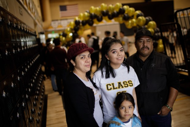 Portrait: Cristo Rey San Jose Jesuit High School graduating senior Daisy Rodriguez, 18, is the first in her family to go to college. Pictured are her mother, Ana Galindo, father, Ricardo Rodriguez and younger sister, Dayani Rodriguez, 5. Rodriguez will attend Princeton University in New Jersey in the fall. (Dai Sugano/Bay Area News Group)