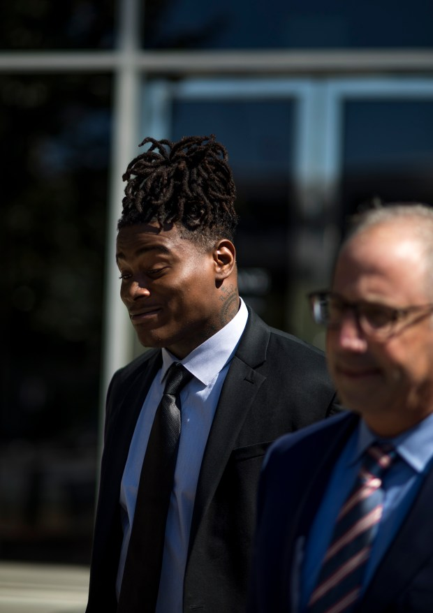 San Francisco 49ers' linebacker Reuben Foster, left, and his attorney Joshua Bentley, right, walks out of the Hall of Justice in San Jose, Calif., on Wednesday, May 23, 2018. A judge dismissed domestic violence charges against Foster and downgraded an assault rifle charge to a misdemeanor on Wednesday. (Randy Vazquez/ Bay Area News Group)