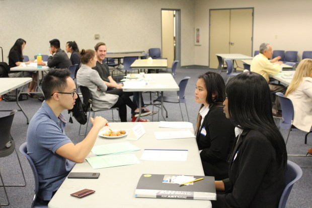 Independence High School seniors Jada Spencer, far right, and Fatima Lagmay are interviewed by Brandon Yung, left, a product designer for eSports group Team SoloMid, during the school's Mock Interview Extravaganza held May 4, 2018. (Courtesy of Will Stegeman)