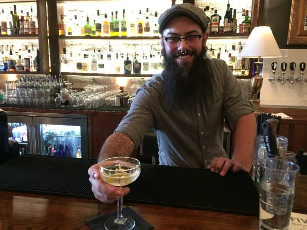 Five Points bartender Aaron Luevano serves a martini at the popularcocktail lounge at San Jose's San Pedro Square. (Sal Pizarro/Bay Area News Group)