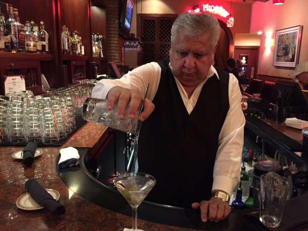 Bartender Dave Sanchez pours a martini at Original Joe's, a downtownSan Jose institution. (Sal Pizarro/Bay Area News Group)