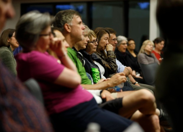 "Audience members listen to Margaret Petros tells her story about leaving Iraq for the program ""When Home Won't Let You Stay: Stories of Escape and Refuge"" at the Mitchell Park Community Center in Palo Alto, Calif., on Thursday, May 10, 2018. (Nhat V. Meyer/Bay Area News Group)"