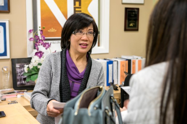 VNHELP President and Executive Director Thu Do, left, speaks with a donor at the VNHelp office in Milpitas, California, on Thursday, March 22, 2018. (LiPo Ching/Bay Area News Group)