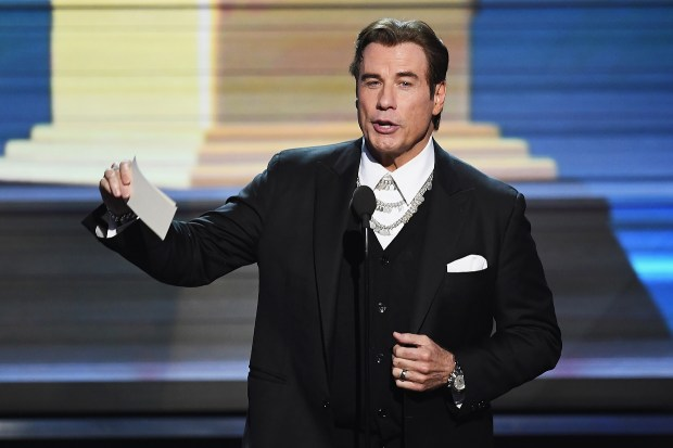 Actor John Travolta speaks onstage during The 59th GRAMMY Awards at STAPLES Center on February 12, 2017 in Los Angeles, California. (Photo by Kevin Winter/Getty Images for NARAS)